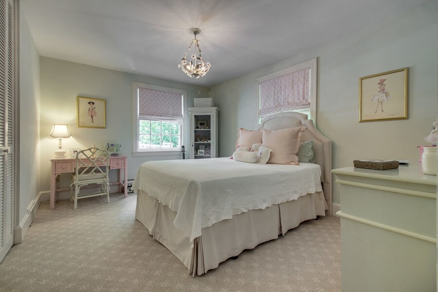 This upstairs bedroom is lovely — a little girl's dream!