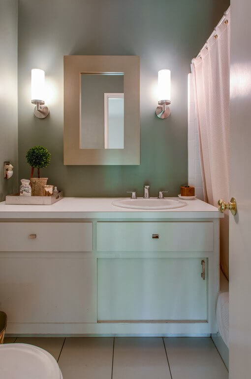 Tasteful fixtures and warm tones make this bathroom a beauty.