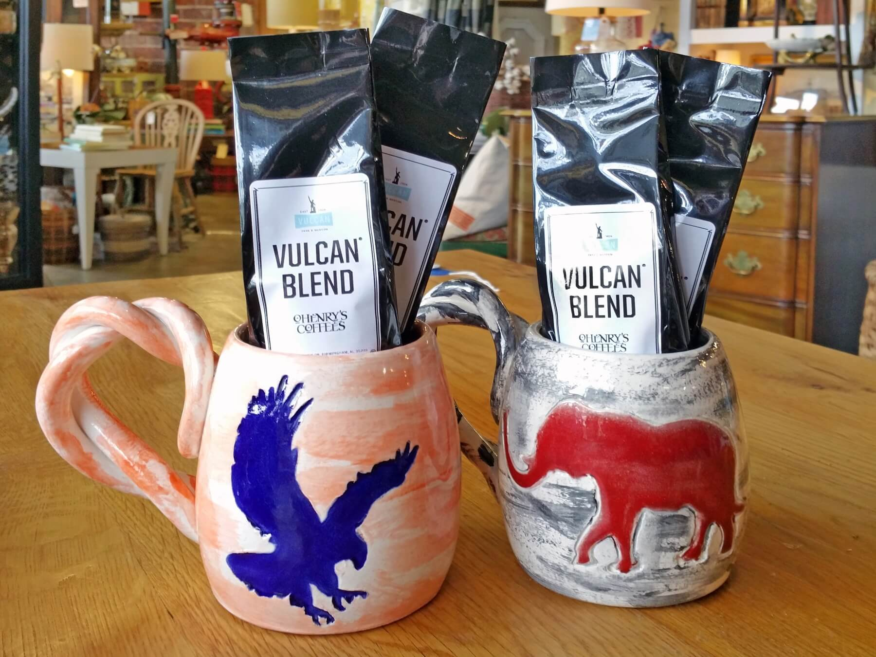 Auburn and Alabama mugs, $25, and miniature O'Henry's Vulcan Blend coffee, $3.99 each, at Homewood Antiques