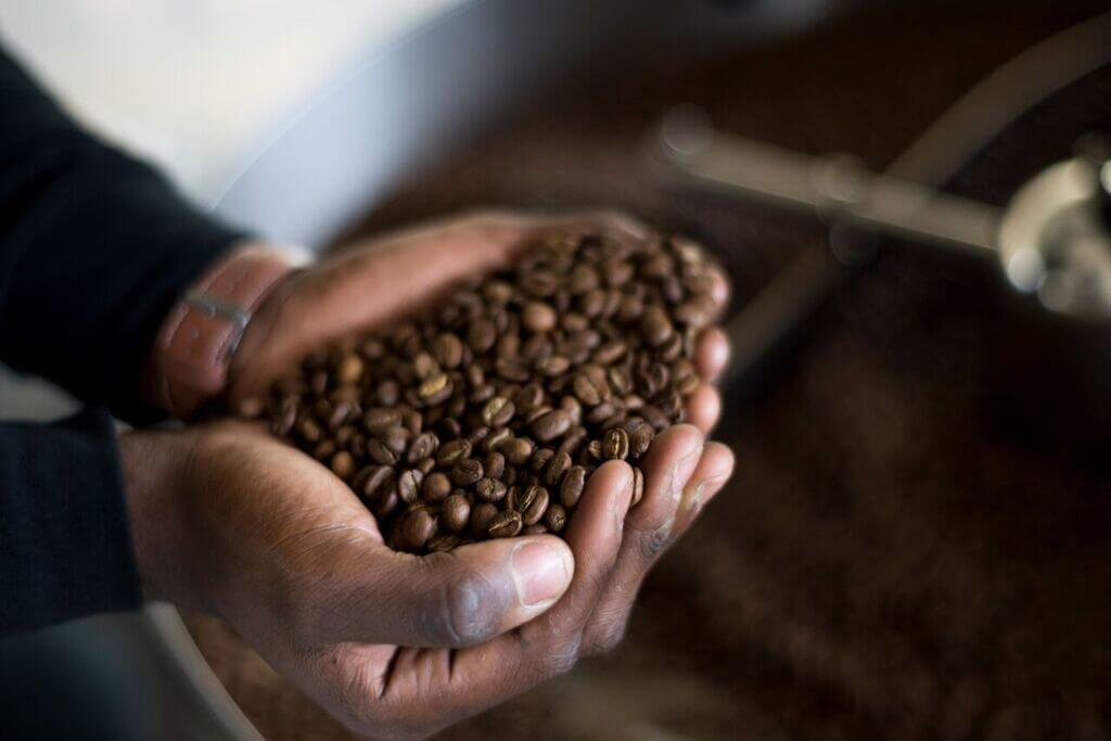 We can almost smell this aromatic handful of freshly roasted coffee beans.