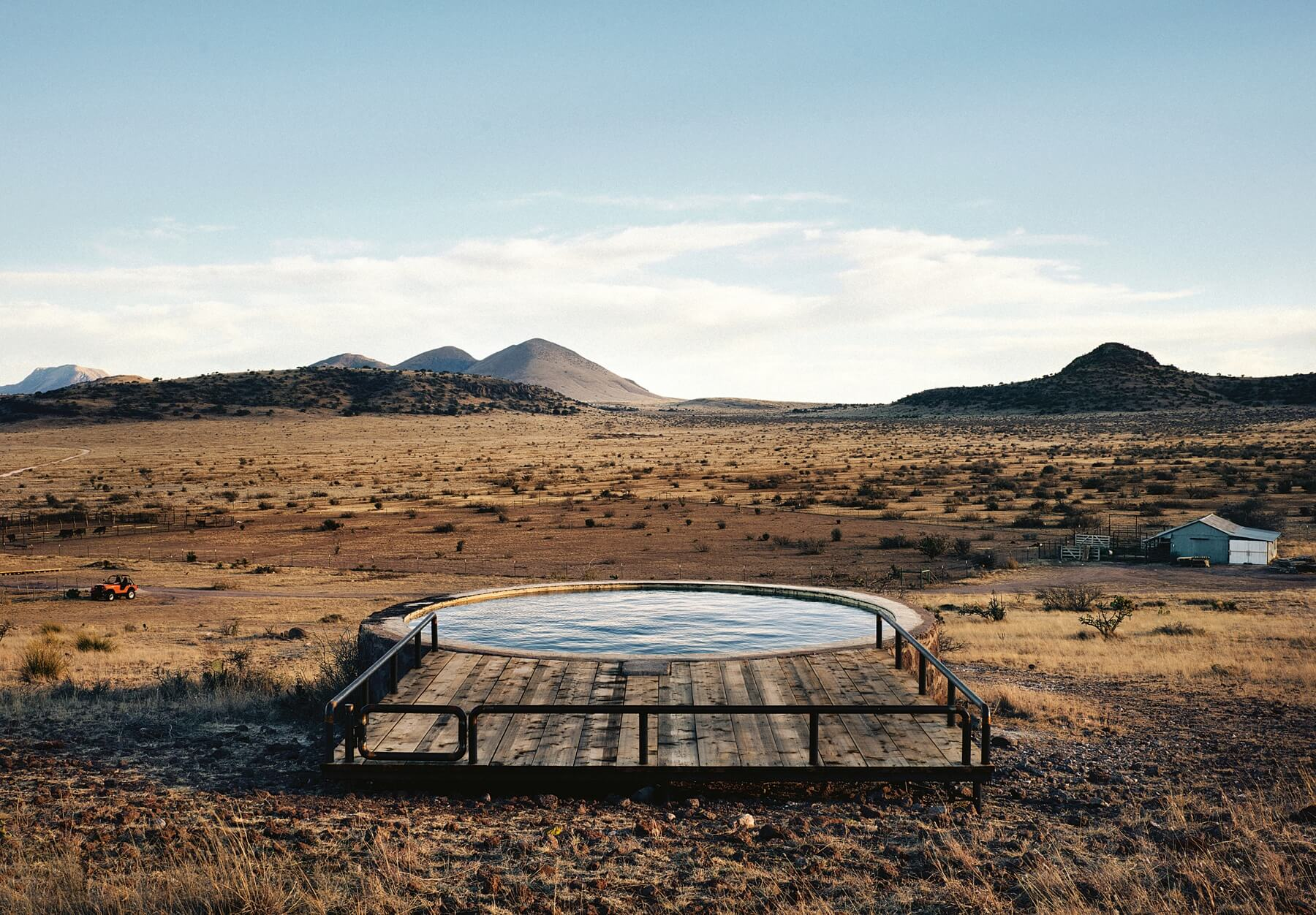 A water tank, a short jaunt from the 1930s-era bunkhouse doubles as the home's swimming hole.