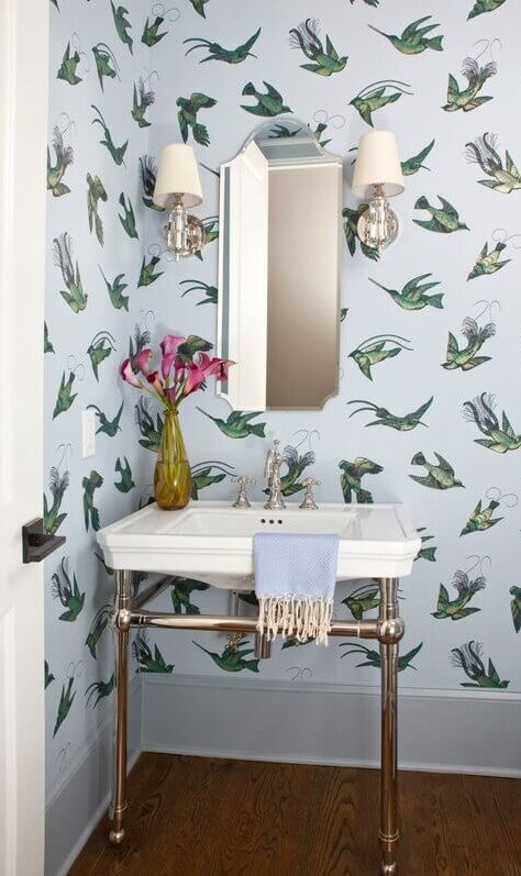 Wallpaper by Cole & Son (cole-and-son.com) brings an unexpected element to the powder room.