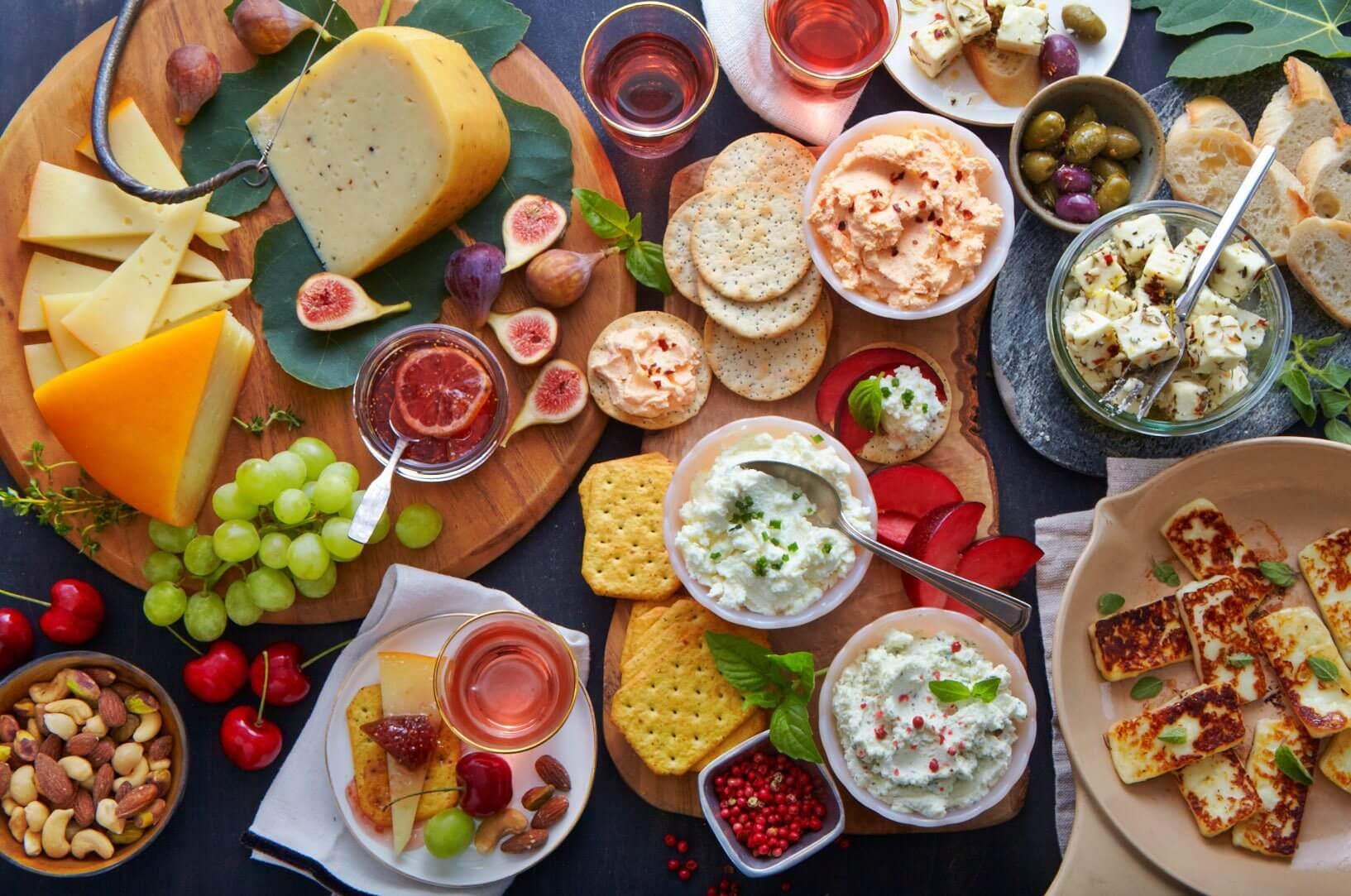 A gorgeous bacchanalian spread of Dayspring Dairy cheeses, figs, cherries, grapes, olives, nuts, bread and crackers and wine | Image: Dayspring Dairy
