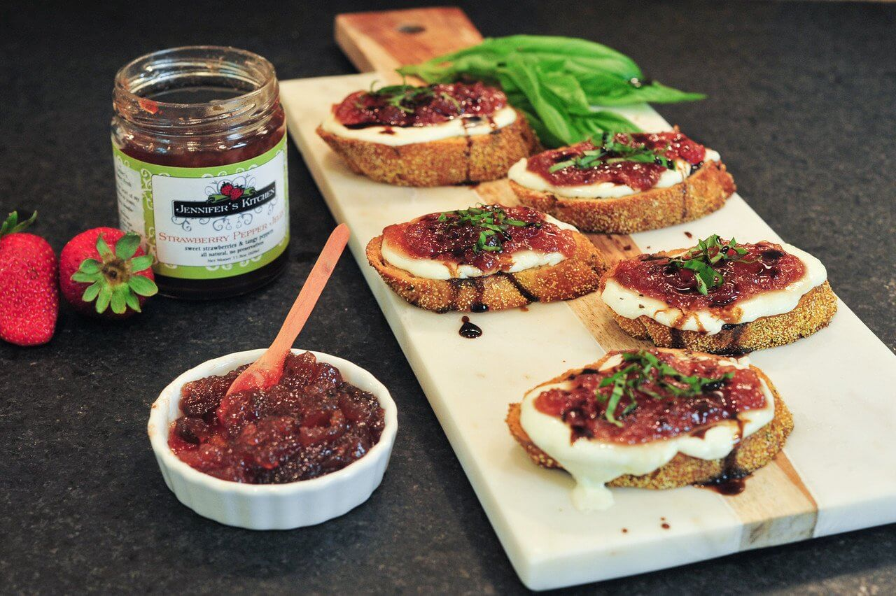Savory melted Brie complements sweet strawberry pepper jelly on baguette toasts with fresh basil. Image: Jennifer's Kitchen
