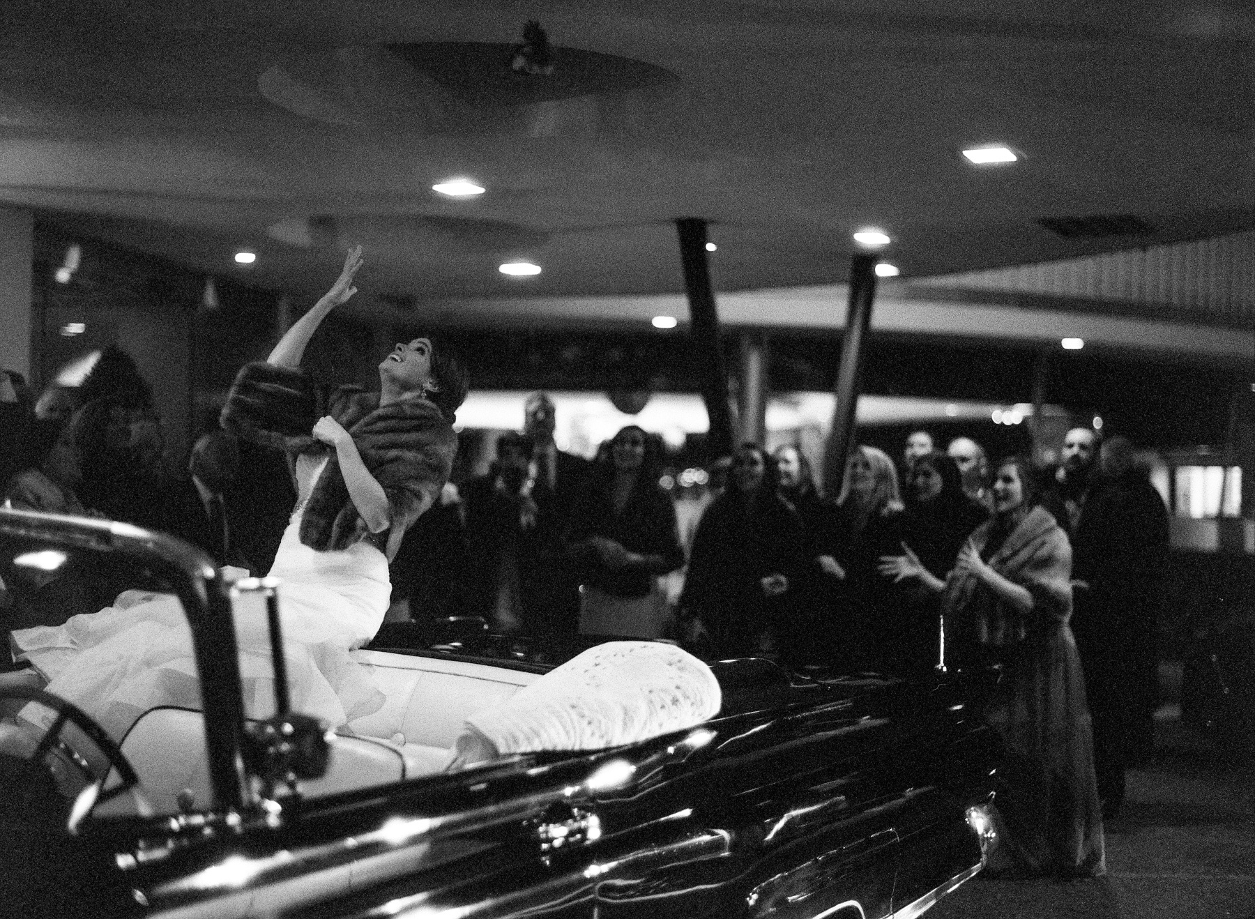 """Our getaway car, a vintage 1959 Lincoln Continental convertible, belongs to my step-dad,"" Amy says. ""Despite the cold, we were able to ride off with the top down and I tossed by bouquet from the top of the backseat."""