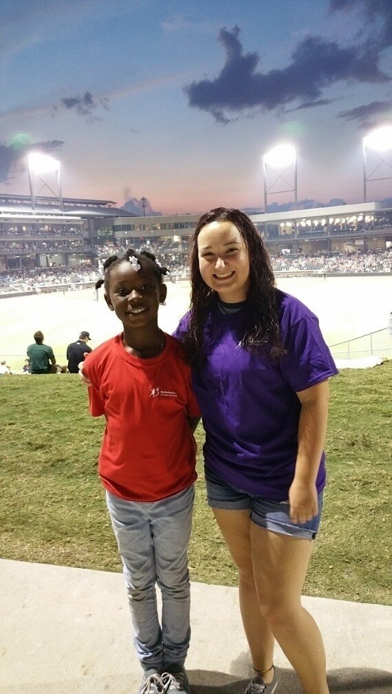 "A ""Big Sister"" and ""Little Sister"" hang out at a Baron's game. Image: Big Brothers Big Sisters of Greater Birmingham"