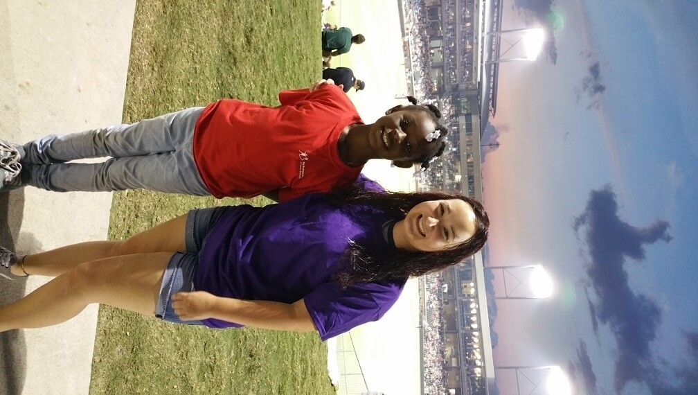 """A """"Big Sister"""" and """"Little Sister"""" hang out at a Baron's game. Image: Big Brothers Big Sisters of Greater Birmingham"""