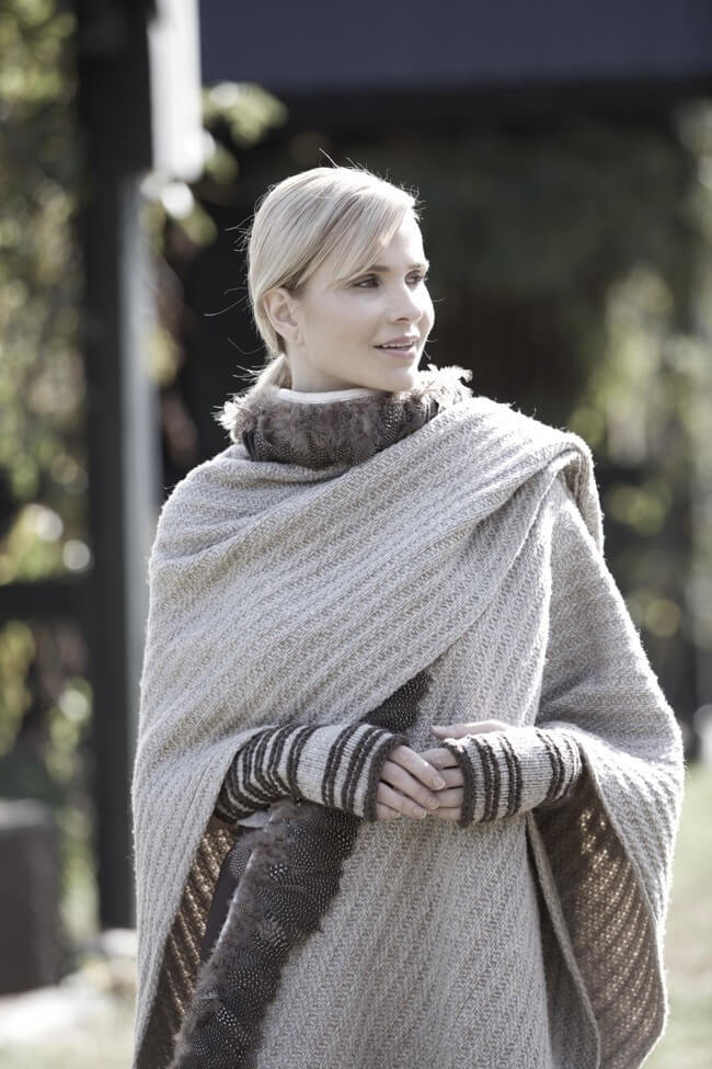 Sweater wrap cape with guinea feather trim and fingerless gloves | Image Cade Martin Photography