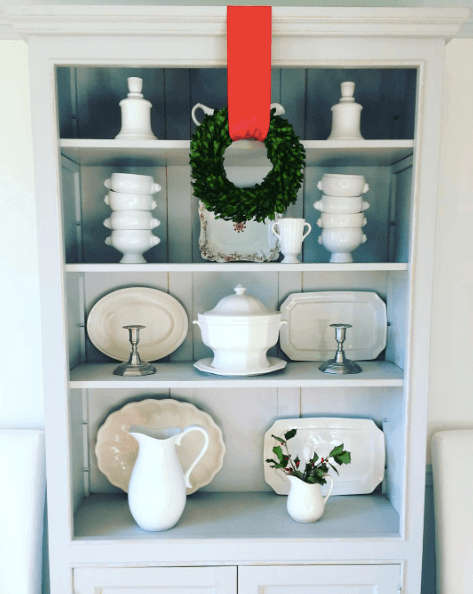 Add inexpensive wreaths and sprigs of greenery throughout your entire home to make guests feel welcome.