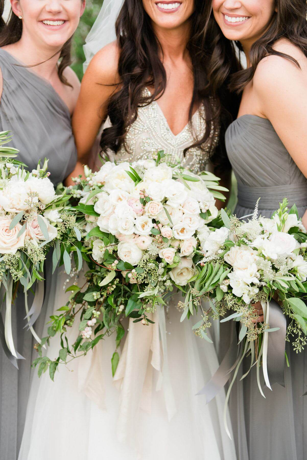 HotHouse Design Studio created these beautiful neutral cream and blush bouquetsteeming with greenery and soft flowing ribbons from Silk & Willow for a truly stunning bridal accessory.