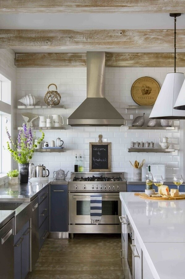 The kitchen is a mix of modern and European, with blue glass-backed cabinets, stainless and quartz countertops.