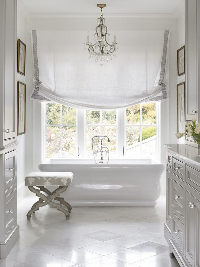 Who wouldn't want to relax in that beautiful tub in this serene bathroom?