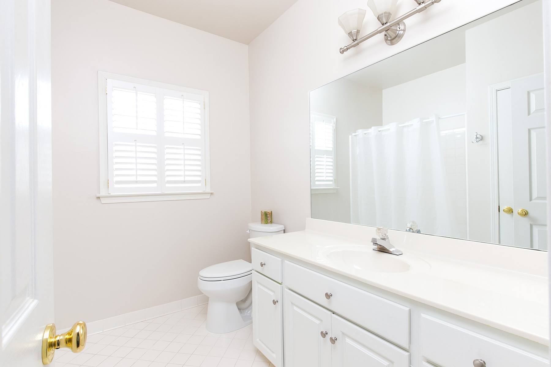 This second upstairs bathroom serves the other two bedrooms.