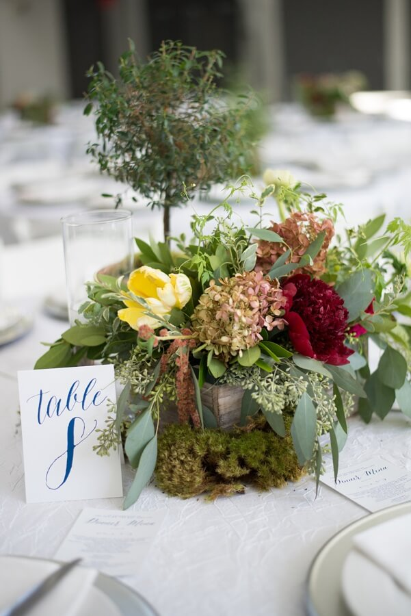 Each table had a centerpiece that came with parrot tulip, peony, bay leaves, eucalyptus, love in a puff vine, antique hydrangea and Amaranthus myrtle topiary.