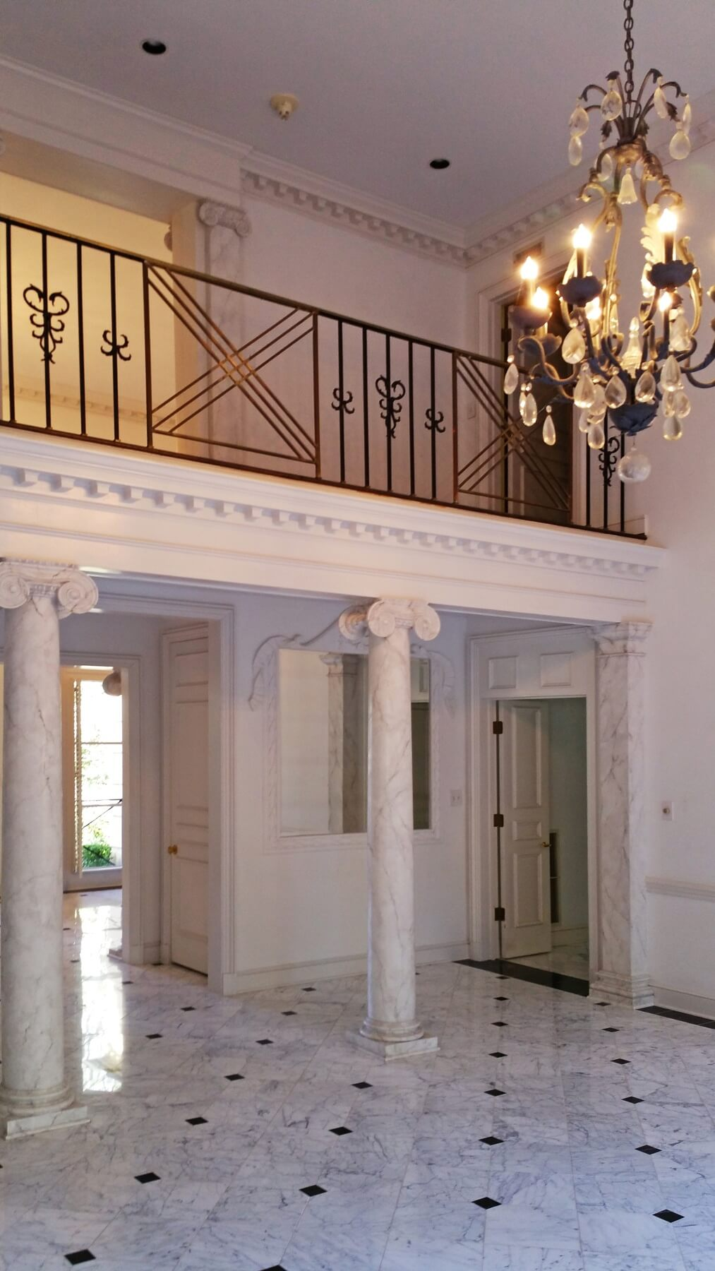 Before: A view of the dining room looking into the light-filled foyer