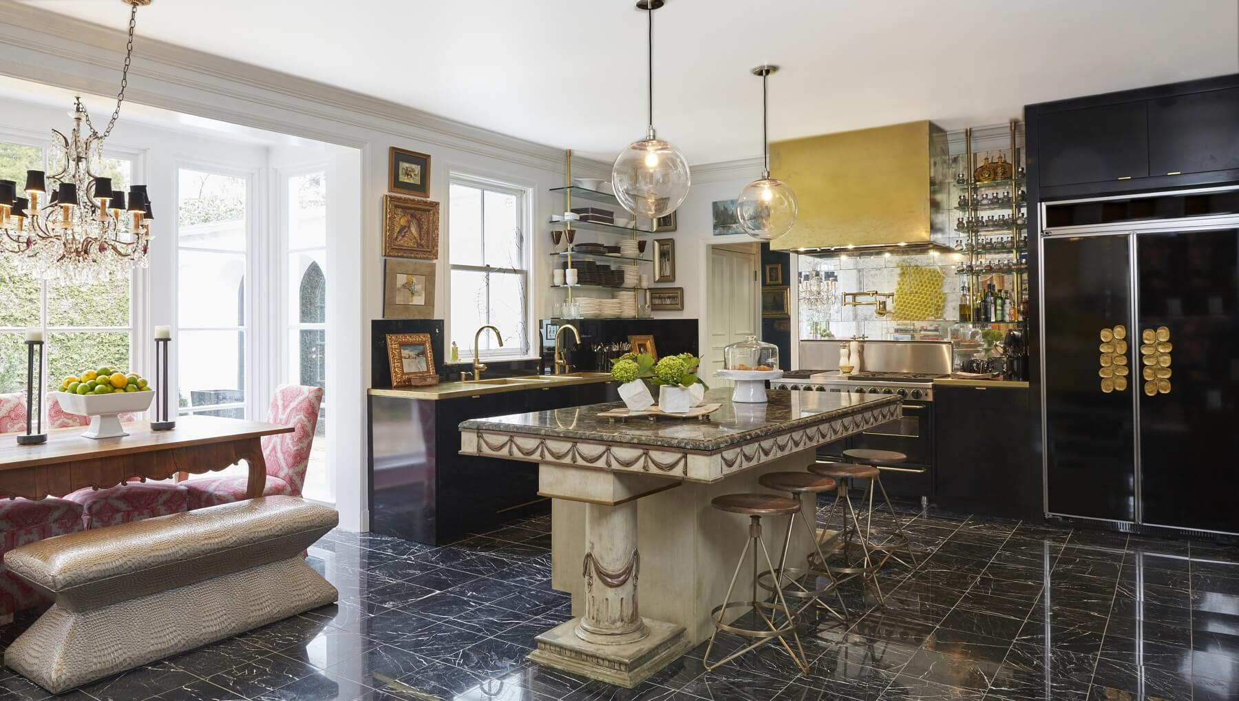 """The kitchen was a total re-do. I had our old dining room table raised to serve as the kitchen island with an added marble countertop and cabinet underneath. It was a glossy, minimal, contemporary look with unlacquered brass accents,"" says Em. ""The whole thing is somewhere between contemporary and not contemporary, so that you have some sense of history. Antiques bring such warmth and life, your past — you can't just throw everything out that's good just to have the glossy, new and abstract."""