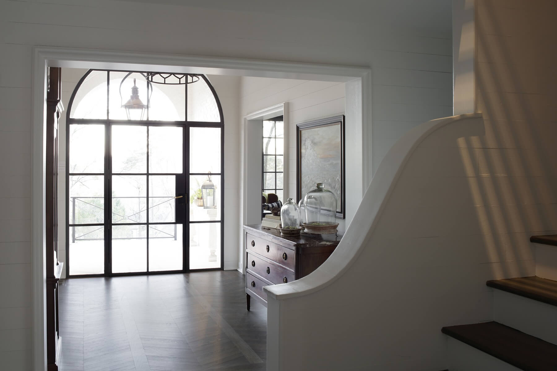 Because the property boasts an impressive view overlooking Country Club Road, Joanna says providing ample natural light through a plethora of windows, like this airy, light-filled foyer, was essential to the home's layout.