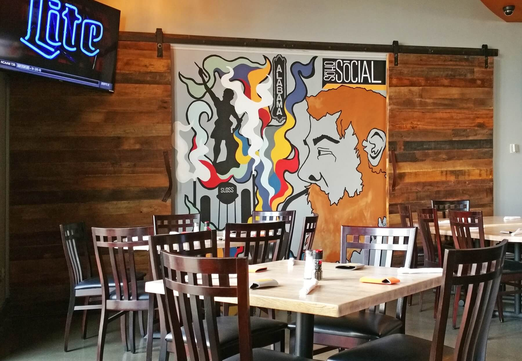The SoHo Social signature mural was painted by the co-owners' talented friend, Sydney Harrington.