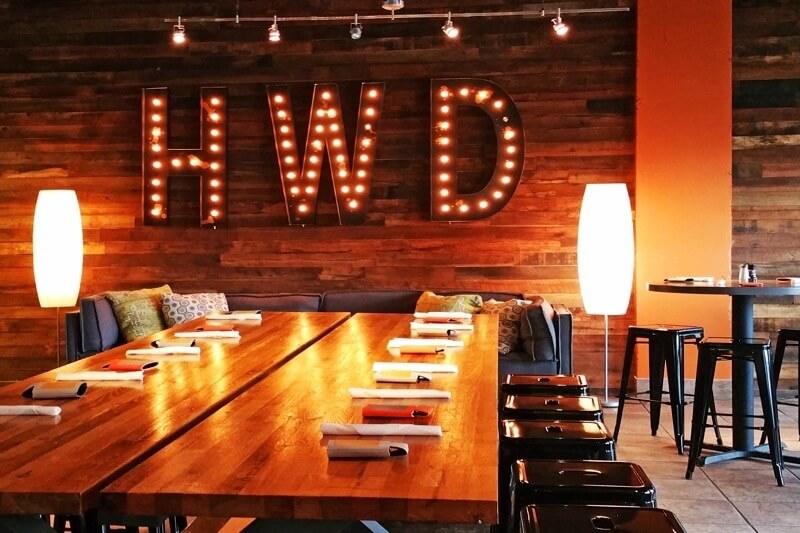 "Nods to Homewood are incorporated throughout the decor, and very much so in this ""HWD"" marquee in the ""Social Room,"" a room that is part lounge, part dining space and can be partitioned off for private parties."