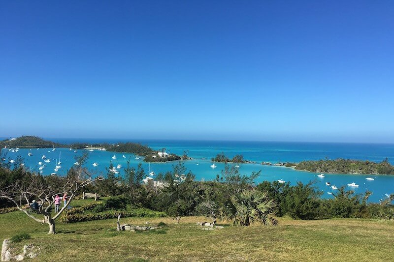 Looking out over Ely's Bay from Scaur Hill Fort Park is one of Bermuda's prettiest views, though ranking them is futile. Look closely and you can see a local plein aire painting group taking in the fresh breeze with their pastels and oils.