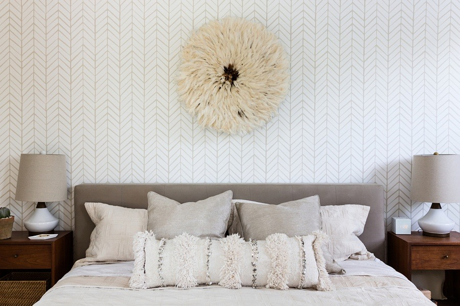 Bethany's headboard is from Crate and Barrel. Both nightstands are vintage finds and the wallpaper is by Serena and Lily.