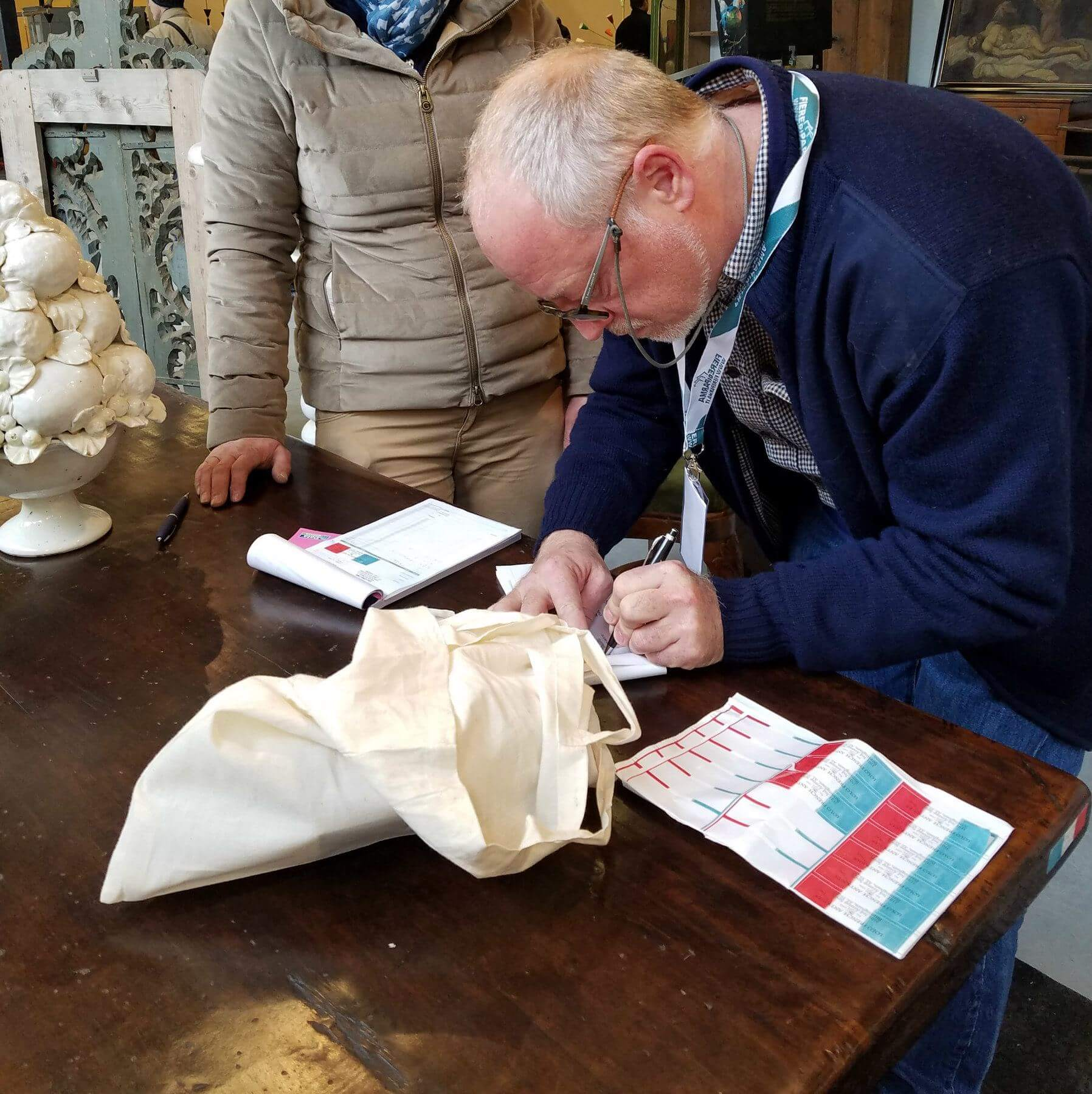 In addition to the robust collection of French antiques, the shop also stocks a selection of Spanish and Italian pieces. In fact, Mimi and Laurent just returned from a buying trip in Italy. Here, Laurent makes a purchase in Parma, Italy. Image: Lolo French Antiques et More