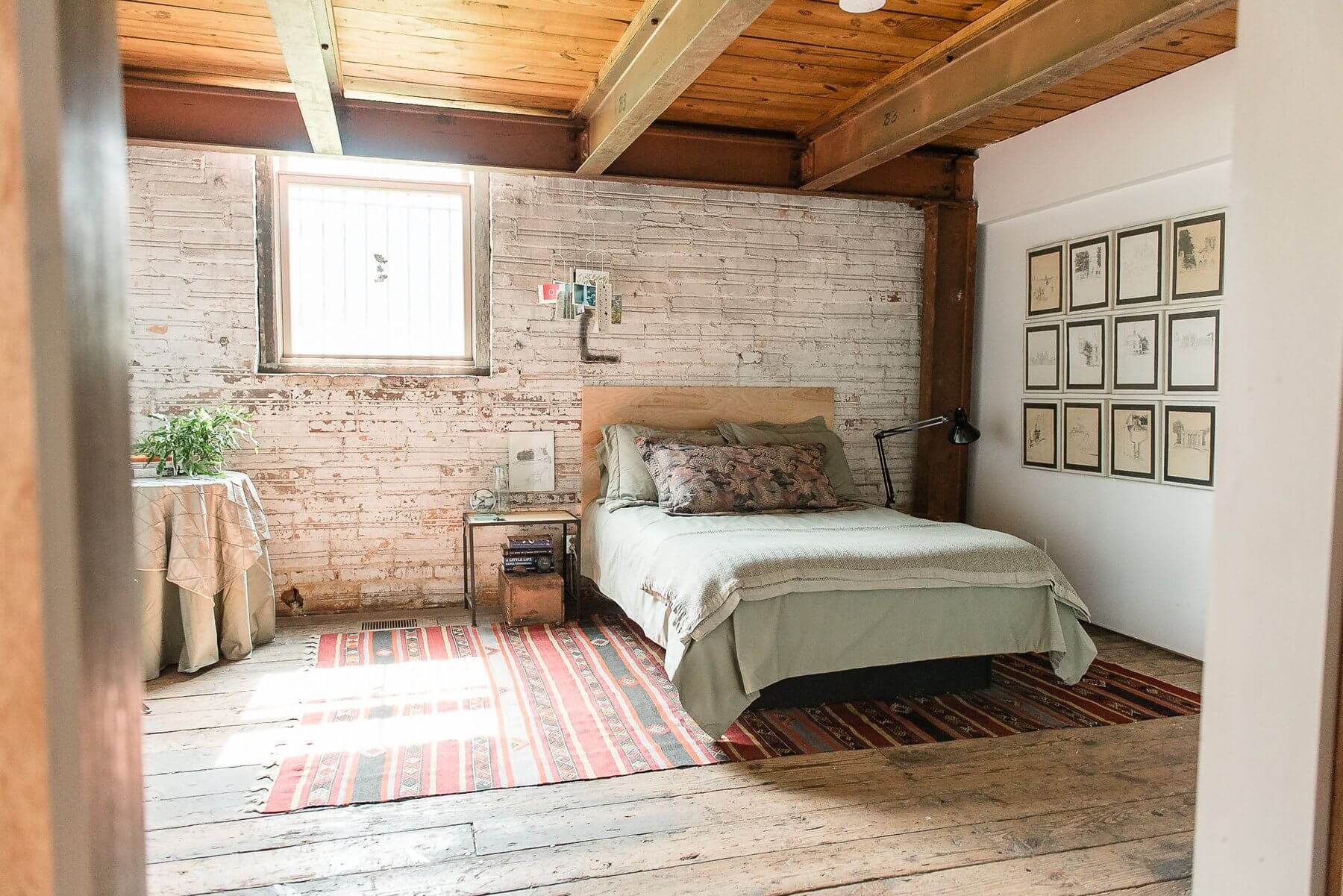 The guest bedroom exudes a rustic warmth that makes us want to cuddle up with a great book!The guest bedroom exudes a rustic warmth that makes us want to cuddle up with a great book!