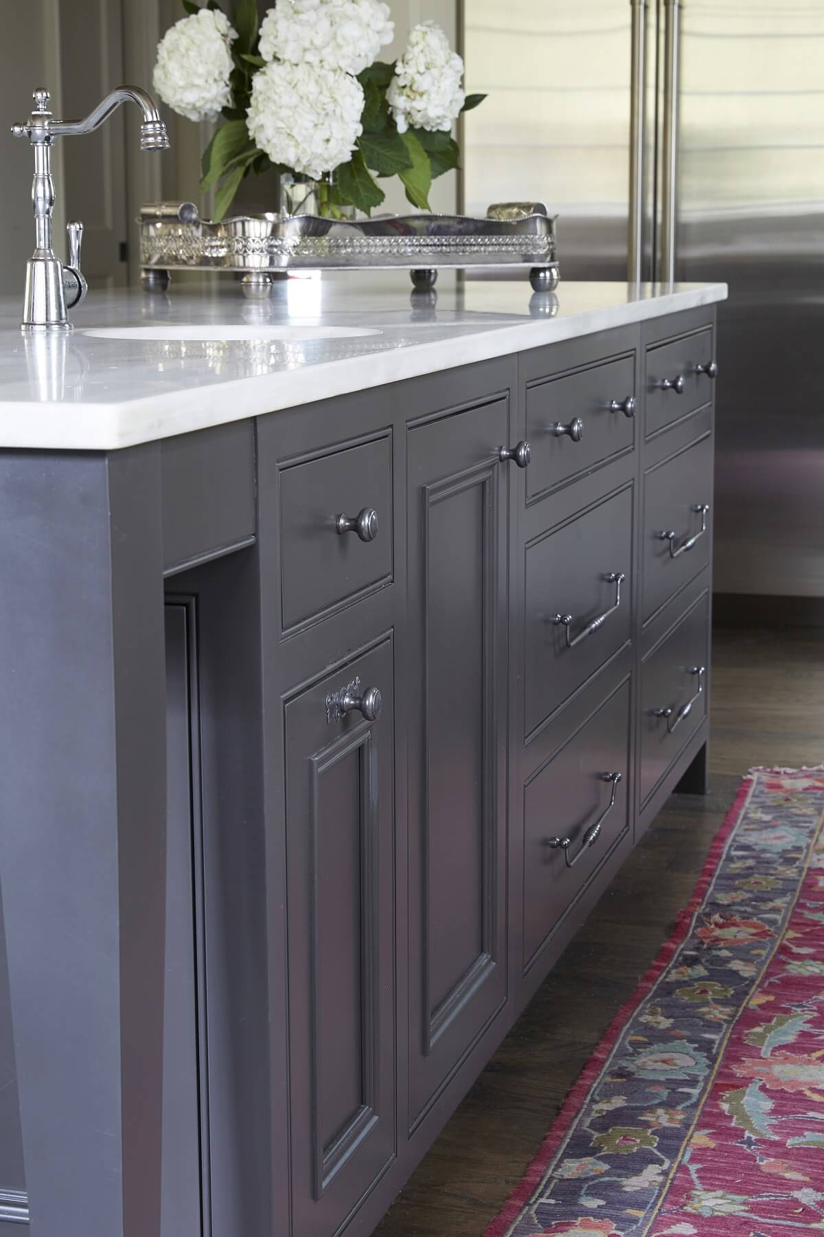 Custom cabinetry and expertly chosen hardware take this island to the next level.
