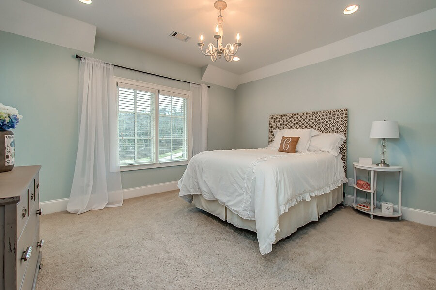 We love the chandelier in this upstairs bedroom!