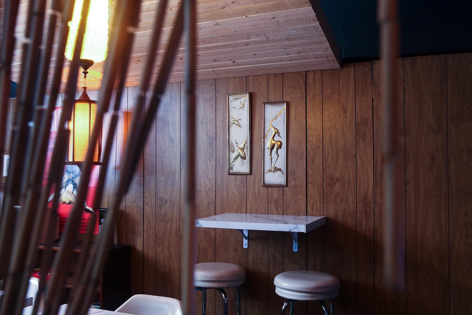 Enter through Angela Davis' head to the tiki lounge, where retro decor and a laid-back vibe set the tone.