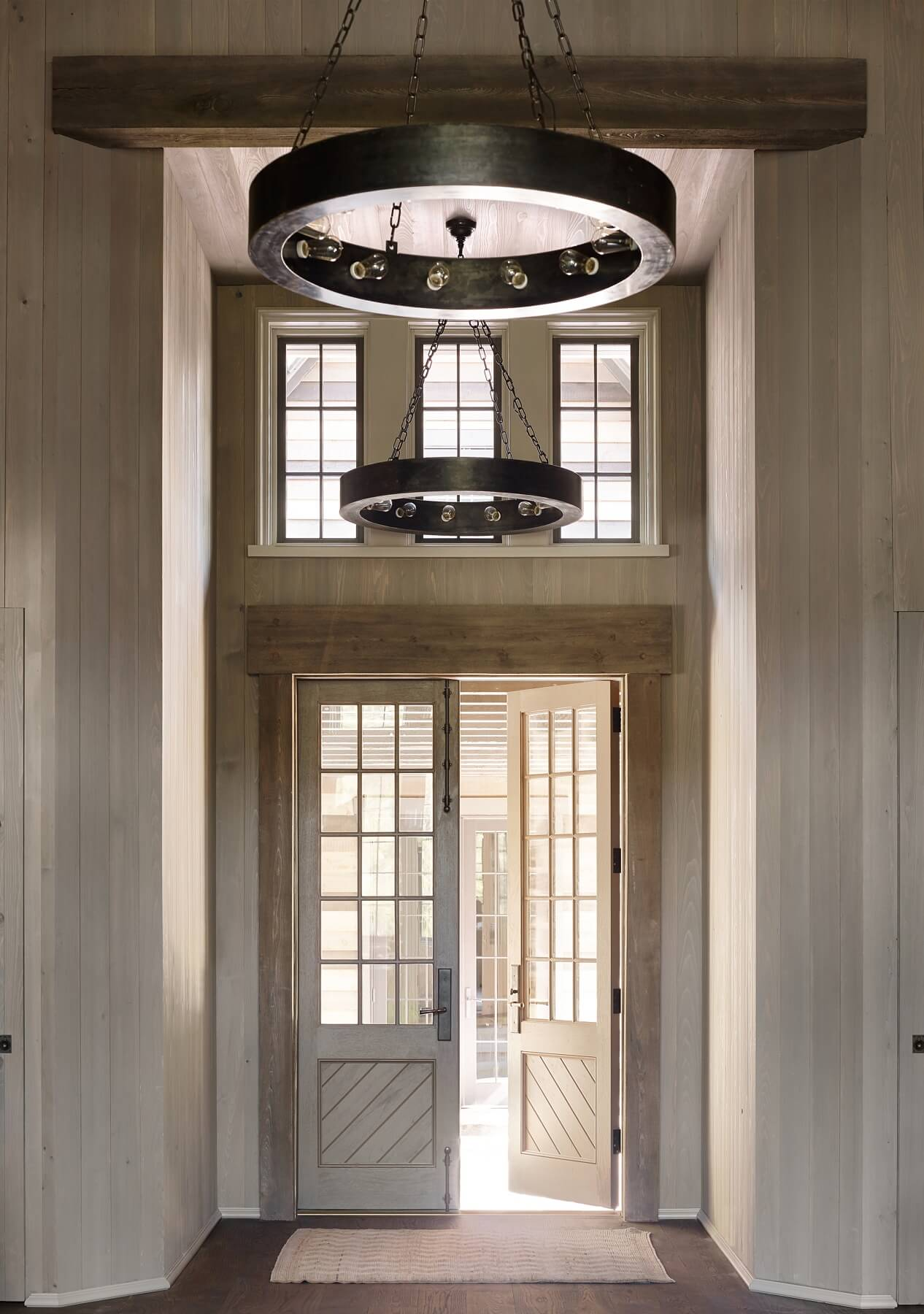 Light floods the foyer for a calming feel, a perfect 'welcome home'!