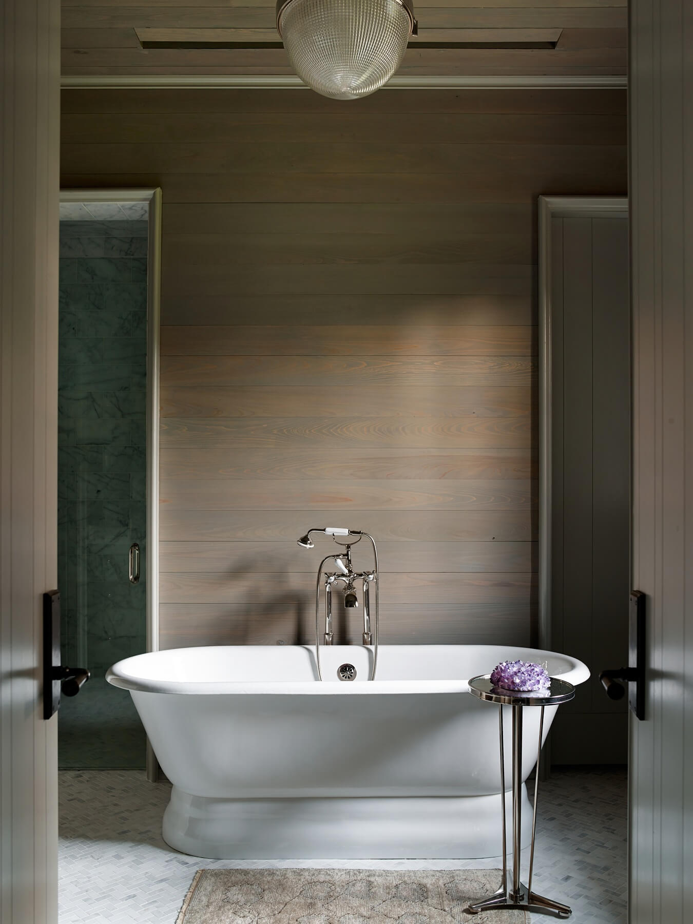 The beautiful bath tub is the centerpiece of this bathroom.