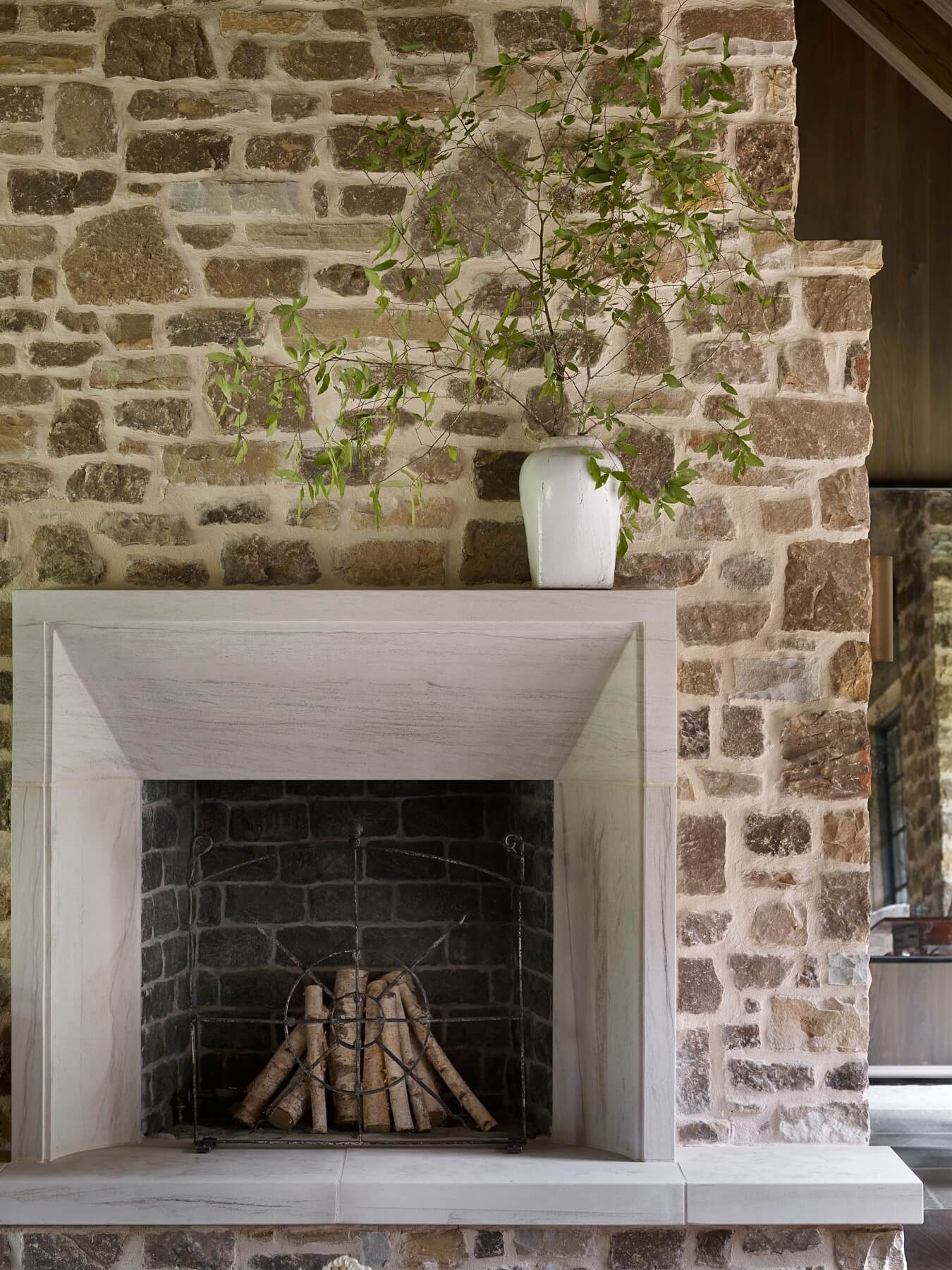 """The fireplace in this room is of the finest limestone I have ever seen,"" says Beth. ""It resembles marble and has a modern edge to the design of it. Still my favorite fireplace to this day!"""