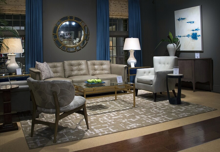 Muted and marvelous, this dramatic take on a living room combines curves with pops of blue for maximum effect.