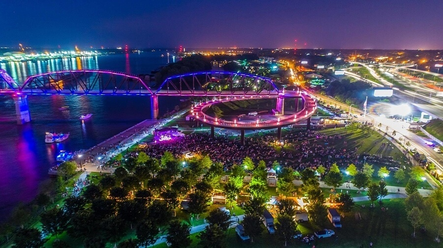 A night view of Waterfront Wednesday crowds and the lights of the Big Four Bridge at night make a spectacular sight