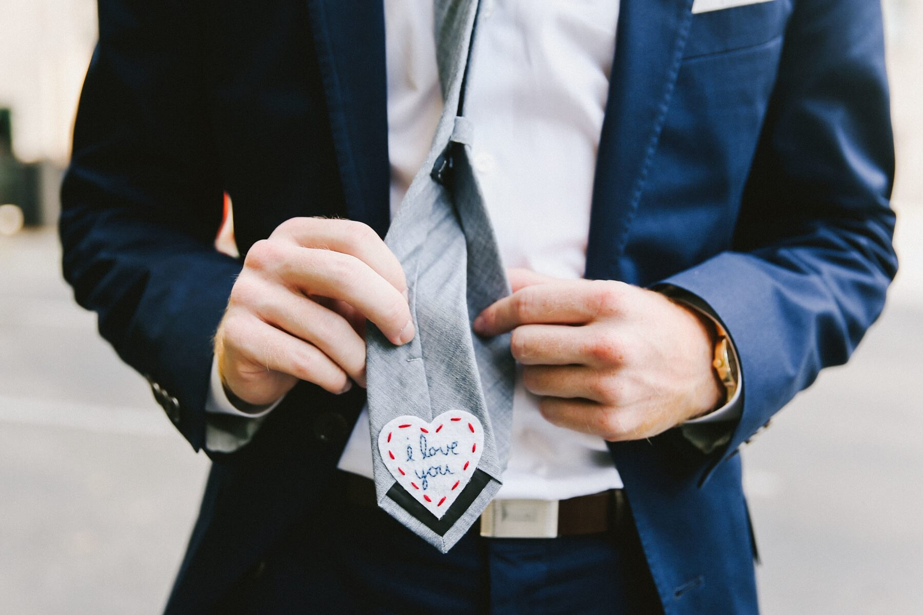 Natalie surprised her groom with this hand-embroidered patch on the back of his tie. It was one of their favorite little details from the day, and is definitely one of ours, too!