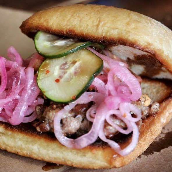 Hamburger with red onion and pickles in Tupelo, Mississippi