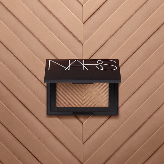 Bronzers, like this one from NARS' new Sun Wash Diffusing line, offer natural, sun-kissed glow. Add a highlighter and you get a radiant bonus. Image: NARS