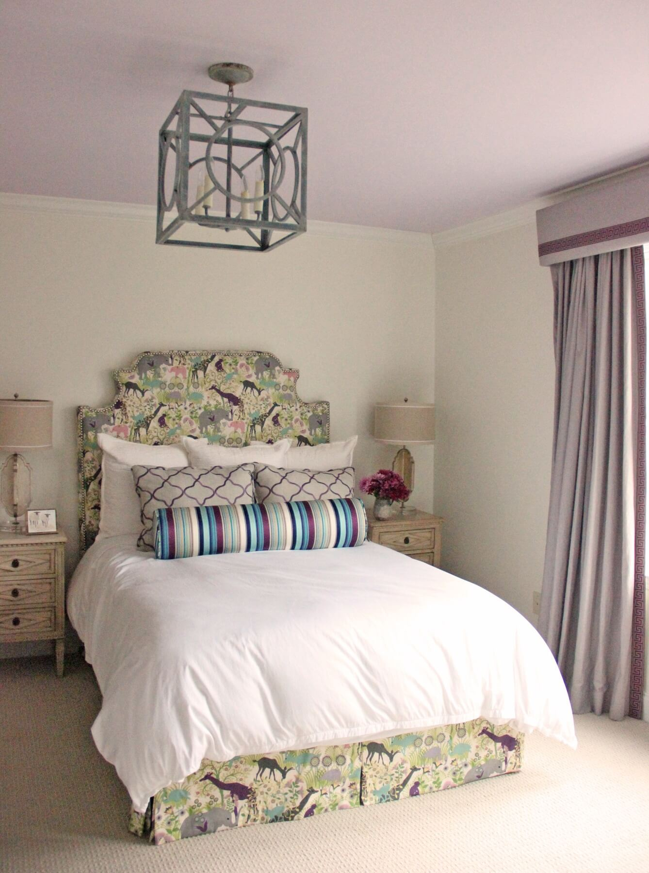"""""""My favorite thing is that the homeowner went with a really fun print on the backsplash and bed skirt,"""" says Marianne of this young girl's room. """"I do feel like kids' rooms should be fun. They are only young once."""" Image: Marianne Strong"""