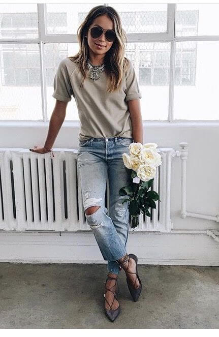 Pairing this boyfriend jean look with a statement necklace and lace-up ballet flats elevates the look. Image: Media