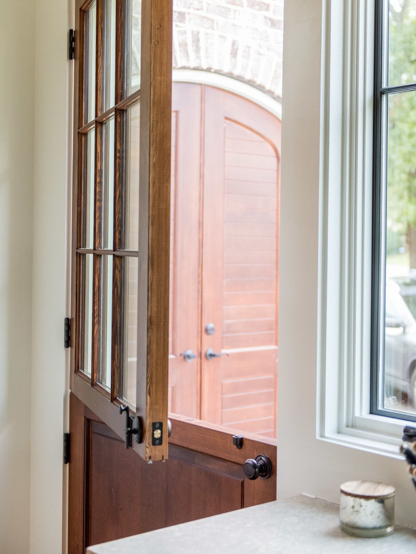 The Dutch door exudes a romantic, Old World feel and a refreshing connection to the great outdoors.