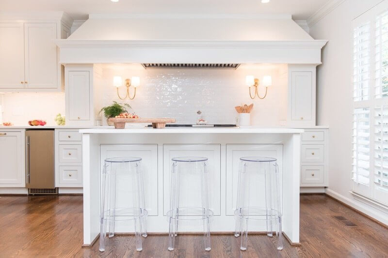 After: What was once the far wall of the dining room space now houses the heart of the kitchen. The new white kitchen is simply stunning.