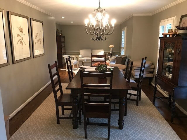 Before: The old dining room extended into a sitting area, a space that was renovated to feature the kitchen range and hood, as well as the kitchen island.