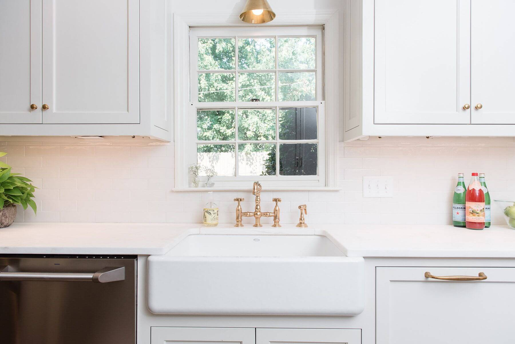 Aged brass from Architectural Heritage provides a timeless feel to the new kitchen.