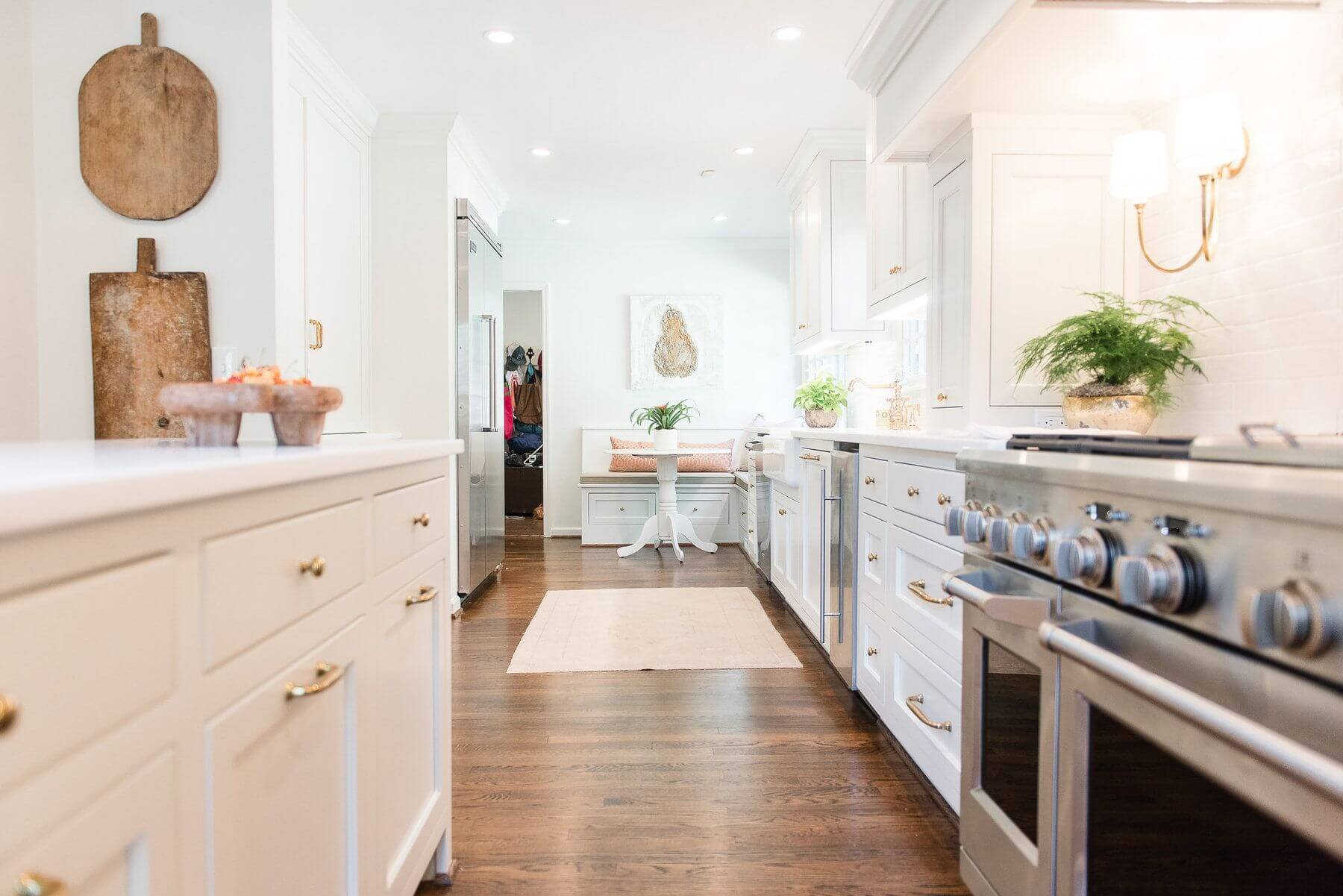 In her new kitchen, Ashley can be with her kids as she cooks, while they do homework at the banquette or hand out at the kitchen island.