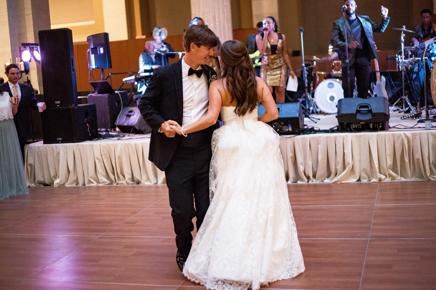 "As Caroline and Johnathan were announced as Mr. and Mrs. Horton, they enjoyed their first dance to ""Signed, Sealed, Delivered"" by Stevie Wonder."