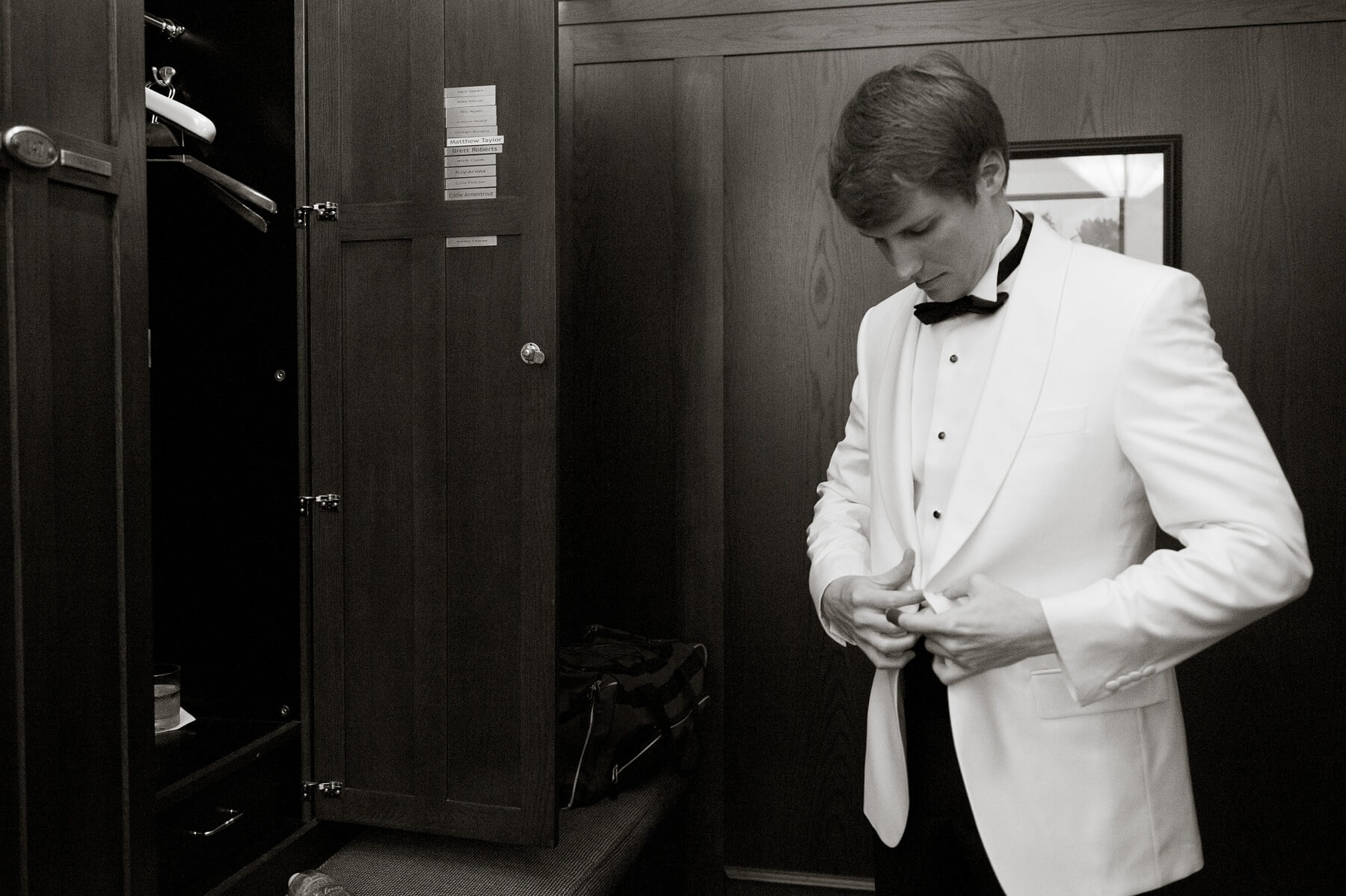 Ryan puts on the finishing touches before seeing his bride for the first time!