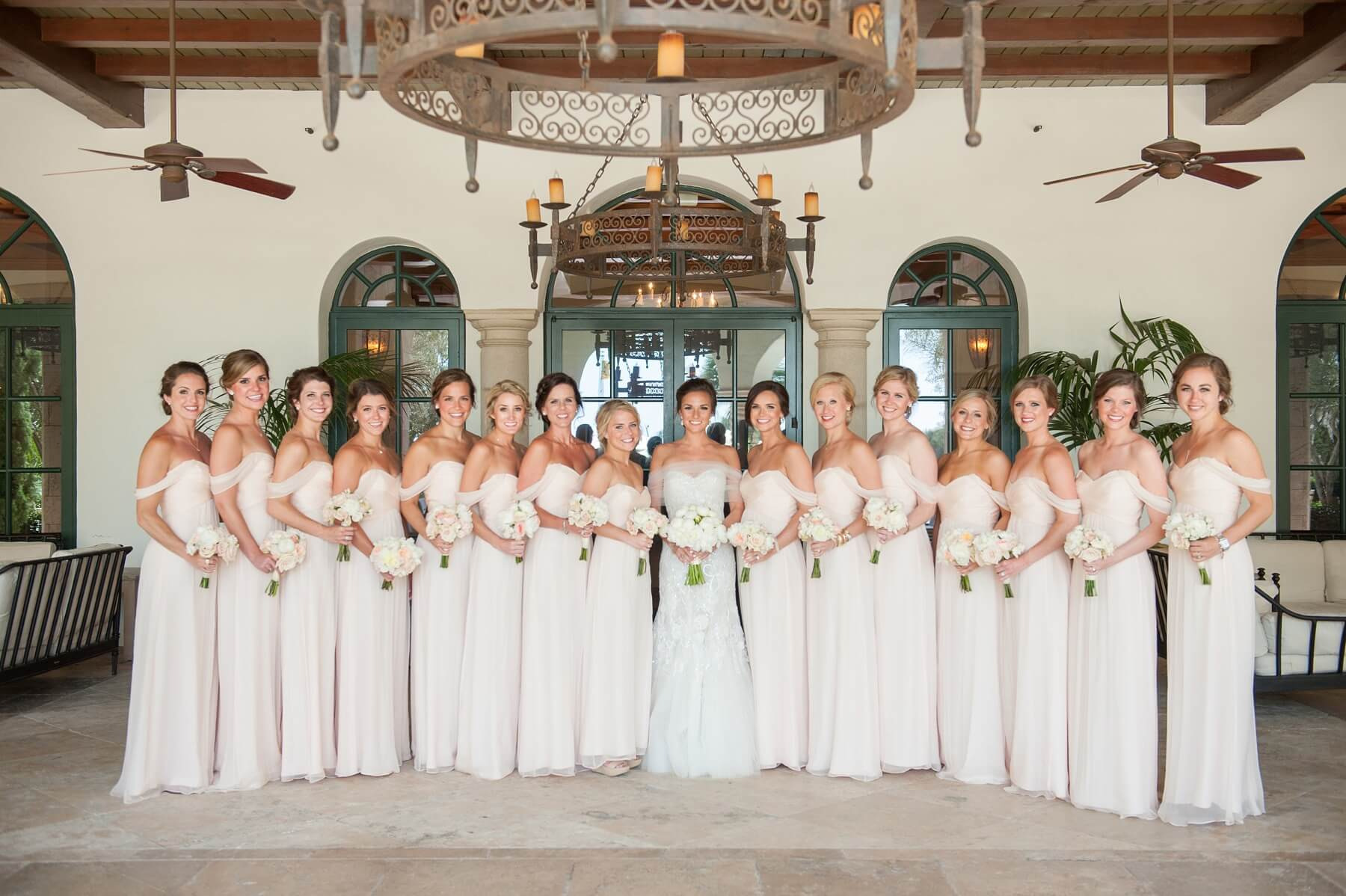 The bridesmaids were stunning in bellini-colored chiffon gowns that elegantly draped off the shoulder, echoing the beautiful tulle wrap Holly wore around her shoulders for the ceremony.