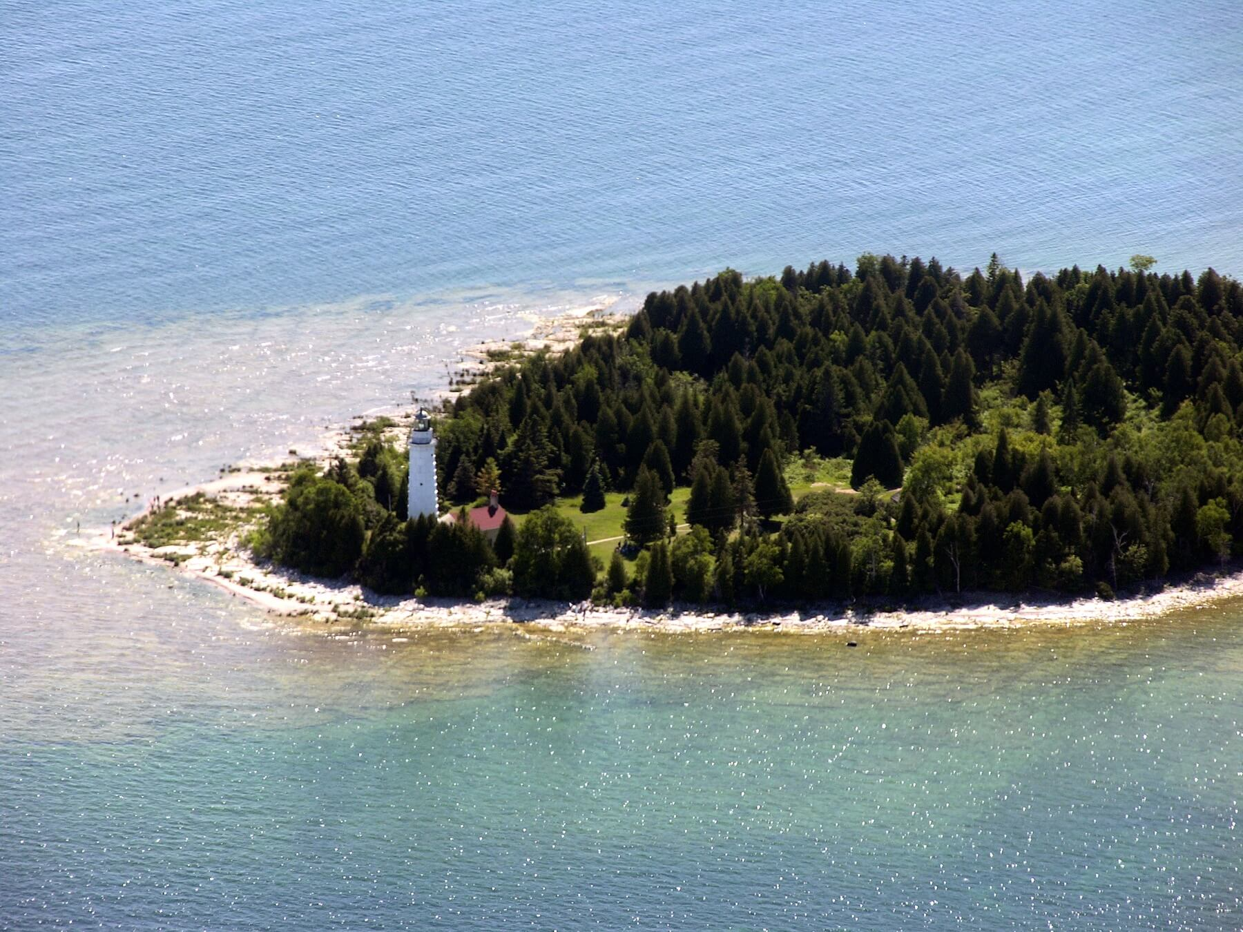 This aerial view of the Cana Island Lighthouse shows just how tall the lighthouse is in comparison to the island. Image: Door County Visitor Bureau