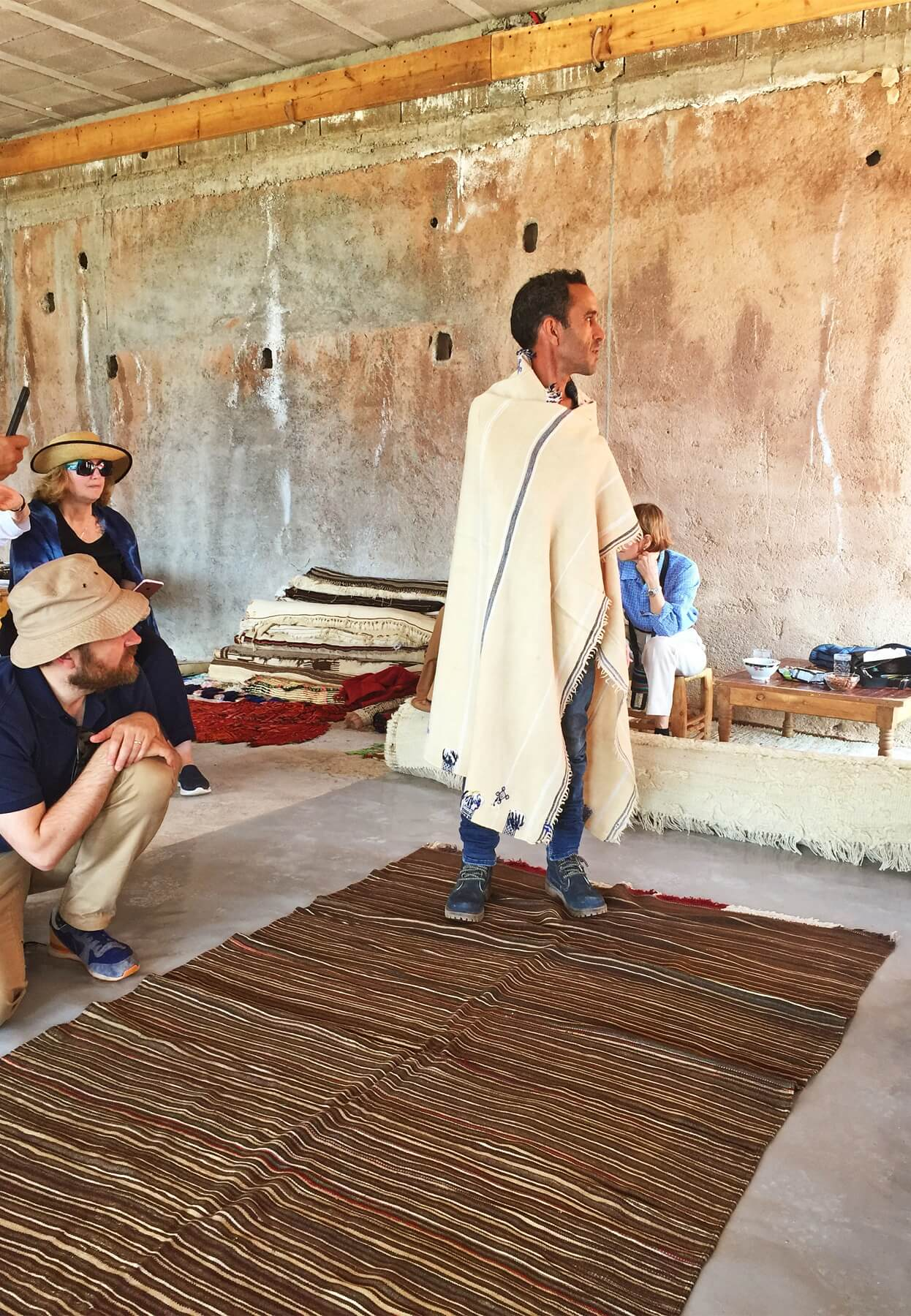 Mustafa Hanseli, lead designer of Jan Kath, shows off his personal collection of rugs and textiles for the group.